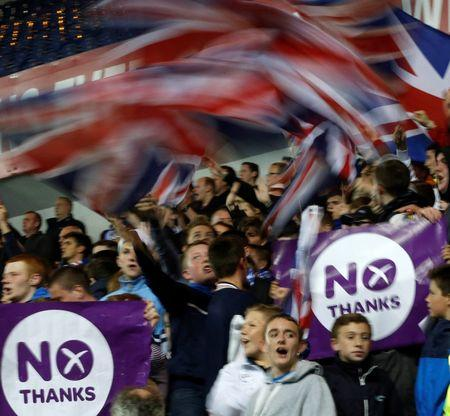 Rangers fans display No Thanks posters during the Rangers versus Inverness Caledonian Thistle soccer match in Glasgow
