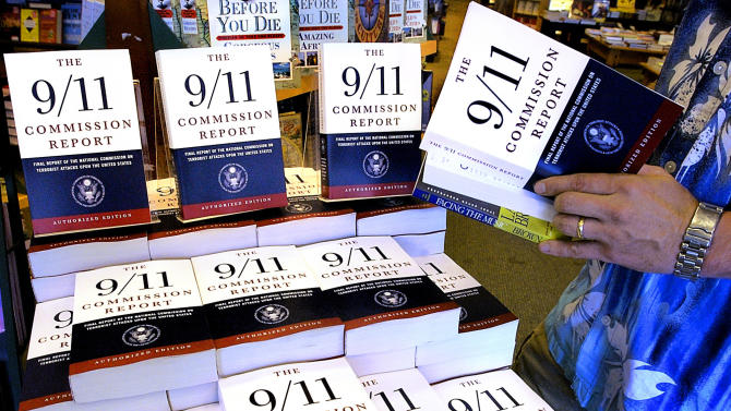 "FILE - In this July 22, 2004 file photo, a patron of the Barnes & Noble bookstore in Springfield, Ill., reads a copy of the ""The 9/11 Commission Report."" We are safer, but not safe enough. In the decade since the 9/11 attacks, the government has taken giant steps to protect the nation from terrorists, spending eye-popping sums to smarten up the federal bureaucracy, hunt down enemies, strengthen airline security, secure U.S. borders, reshape America's image and more. But the effort remains a work in progress, and in some cases a work stalled. The bipartisan 9/11 Commission in 2004 laid out a 585-page road map to create an America that is ""safer, stronger, wiser."" Many of the commission's recommendations are now reality. But in some cases, results haven't lived up to expectations. And other proposals still are just that, ideas awaiting action.  (AP Photo/Seth Perlman, File)"