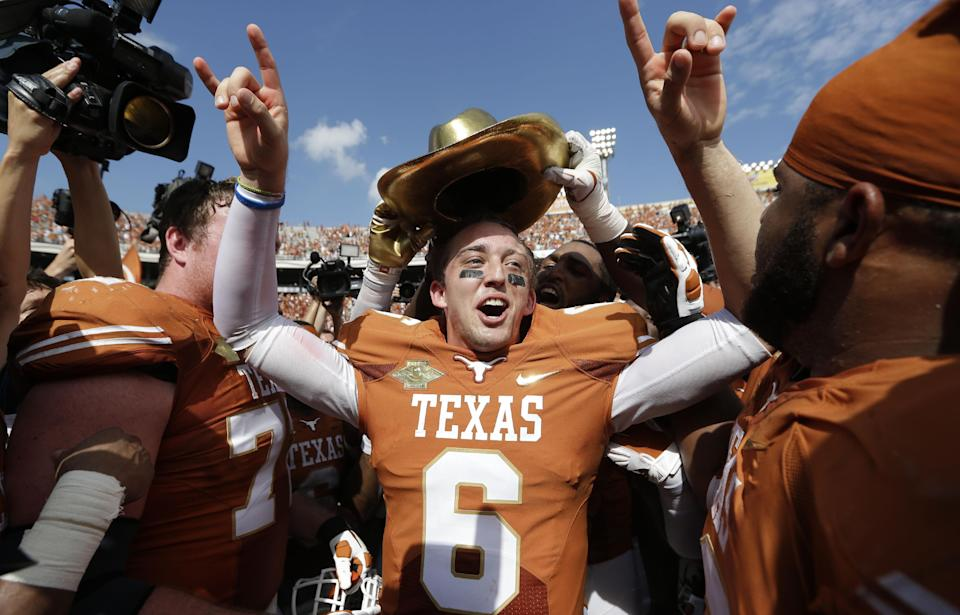 Texas seniors get over OU win for Mack, 36-20