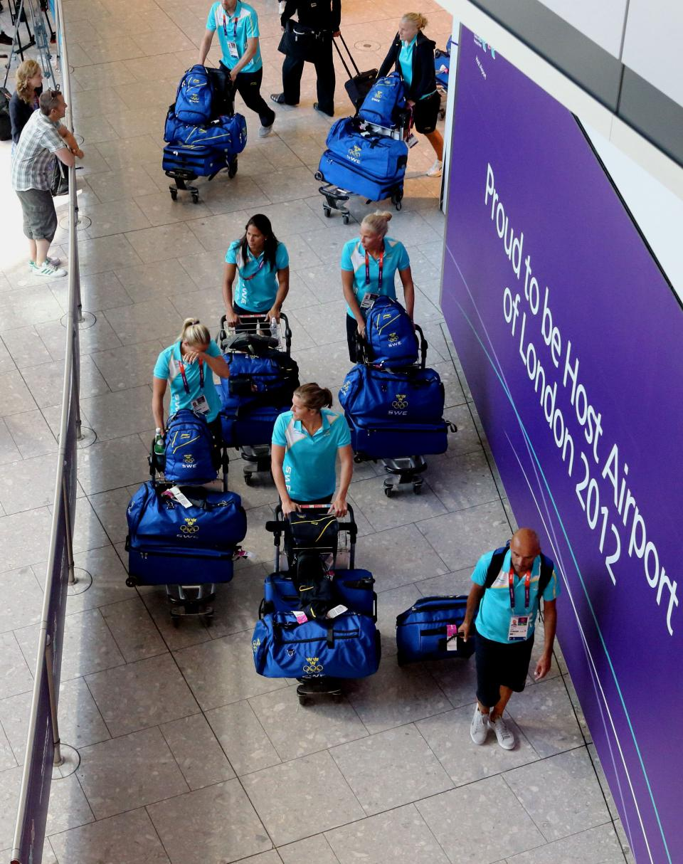 Members of Sweden's Olympic team arrive at Heathrow Airport, in London on Tuesday, July 24, 2012.  The opening ceremonies of the Olympic Games are scheduled for Friday, July 27. (AP Photo/Steve Parsons, PA) UNITED KINGDOM OUT; NO SALES; NO ARCHIVE