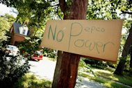<p>A hand-written sign about local power company Pepco hangs on a pole in a residential neighborhood on July 2 in Silver Spring, Maryland. More than a million customers in the storm-hit United States remained without power Wednesday, as canceled firework displays and no air-conditioning made for a miserable July 4 holiday for many Americans.</p>