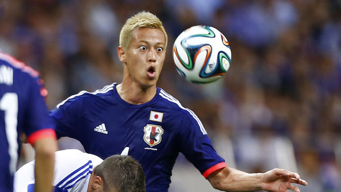 10ThingstoSeeSports - Japan's Keisuke Honda, right, fights for the ball with Cyprus' Giorgos Merkis during a friendly soccer match in Saitama, north of Tokyo, Tuesday, May 27, 2014. Japan will play against Ivory Coast, Greece and Colombia in Group C of the World Cup 2014 in Brazil