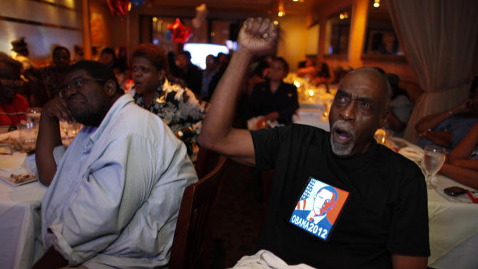 Kinard Lang, right, reacts while watching the first Presidential debate between Republican presidential candidate, former Massachusetts Gov. Mitt Romney, and President Barack Obama on Wednesday Oct. 3, 2012, at a restaurant in the West Oak Lane section of Philadelphia.  (AP Photo/ Joseph Kaczmarek)