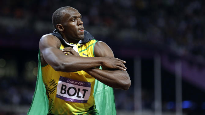 Jamaica's Usain Bolt reacts to his win in the men's 100-meter final during the athletics in the Olympic Stadium at the 2012 Summer Olympics, London, Sunday, Aug. 5, 2012.(AP Photo/Anja Niedringhaus)