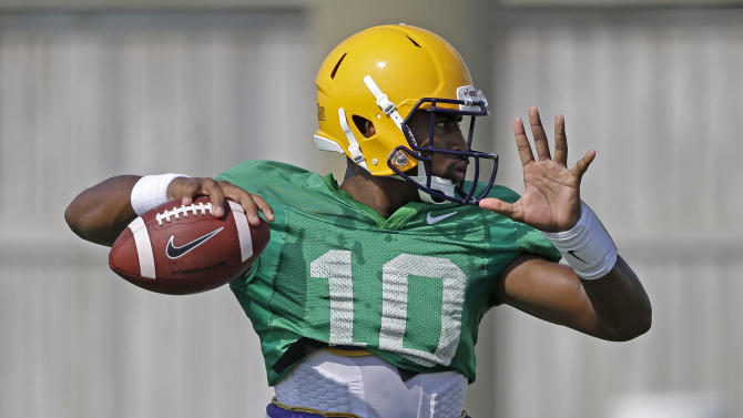 In this Aug. 6, 2014, file photo, LSU quarterback Anthony Jennings (10) passes during their NCAA college football practice in Baton Rouge, La. Tigers coach Les Miles has declared that he will use both sophomore Jennings and freshman Brandon Harris