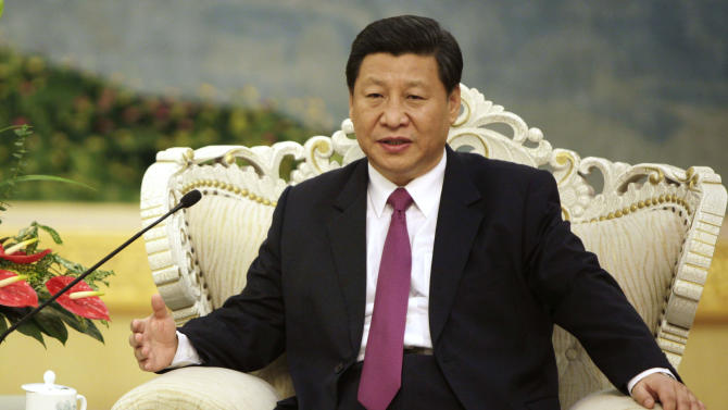 FILE - In this Aug. 29, 2012 file photo, Chinese Vice President Xi Jinping meets with Egypt's President Mohammed Morsi at the Great Hall of the People in Beijing.  Leadership changes are imminent in East Asia's dominant economies,China, Japan and South Korea, in the midst of territorial disputes that could spark conflict. The new leaders who emerge will be crucial in setting the tone for relations with the next occupant of the White House.  How the U.S. gets on with China affects the entire region. Many Asian countries look to China as their main trading partner, but they regard the longstanding U.S. security presence as a defense against China's rapid military buildup. Xi Jinping, who will take the party helm and be anointed China's president in March, is a largely unknown quantity. (AP Photo/How Hwee Young, Pool, File)