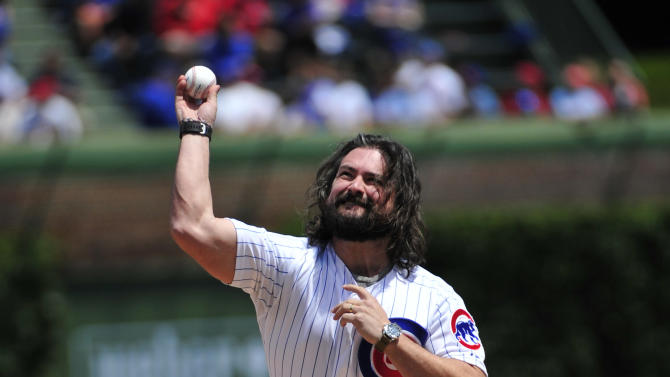 Clay Cook, a member of the Zac Brown Band, throws out the ceremonial first pitch before the first baseball game of a doubleheader between the Chicago Cubs and the St. Louis Cardinals, Tuesday, July  7, 2015, in Chicago.  (AP Photo/David Banks)