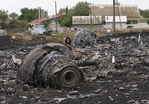 A woman walks at the site of a crashed Malaysia Airlines…