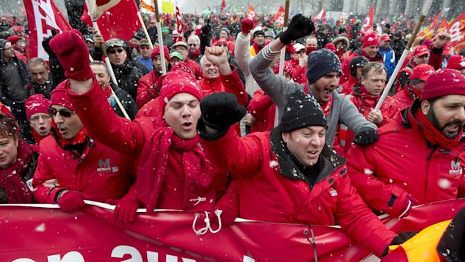 Union members march during a demonstration outside of an EU summit in Brussels on Thursday, March 14, 2013. Thousands of workers are converging on EU headquarters to demand an end to austerity measures in a demonstration coinciding with an EU summit aimed at boosting growth and reducing unemployment. Thursday's protest showed frustration of the European trade union movement claiming years of austerity imposed by EU leaders is only worsening the recession while driving ever more people toward unemployment and poverty.  (AP Photo/Geert Vanden Wijngaert)
