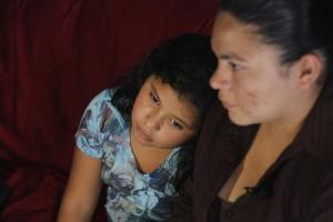 Victoria Cordova and her daughter Genesis Zepeda, both recently deported from the U.S., sit at their home in Tegucigalpa