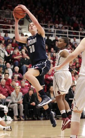 CORRECTS ID AT RIGHT TO  AMBER ORRANGE (33), NOT JASMINE CAMP (23) - Connecticut forward Breanna Stewart (30) drives to the basket against Stanford guard Amber Orrange (33) during the first half of an NCAA college basketball game in Stanford, Calif., Saturday, Dec. 29, 2012. (AP Photo/Tony Avelar)