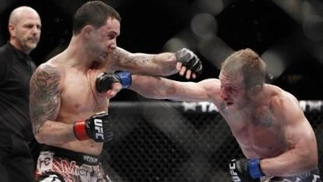 Frankie Edgar, left, trades punches with Gray Maynard during the fifth round of their UFC lightweight mixed martial arts title match