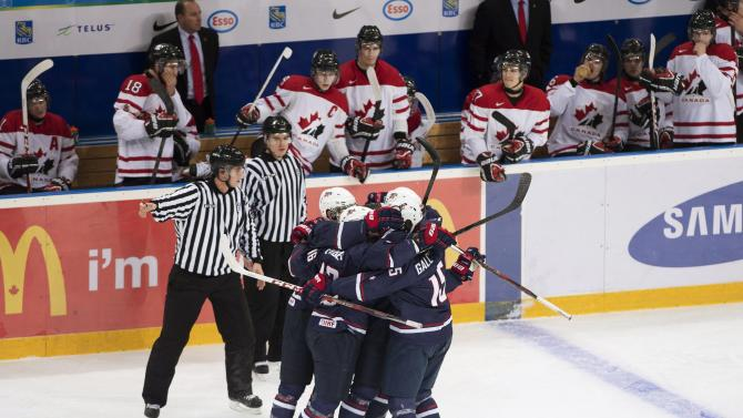 Canada's players watch as Team USA celebrates a goal during first period semi-final IIHF World Junior Championships hockey action in Ufa, Russia on Thursday, Jan. 3, 2013. (AP Photo/The Canadian Press, Nathan Denette)