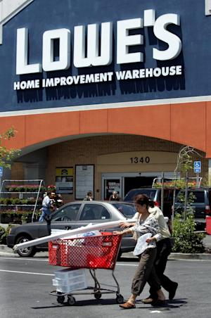 "FILE - In this May 22, 2006 file photo, customers leave a Lowe's Home Improvement Warehouse store in San Bruno, Calif. California State Sen. Ted Lieu , D-Torrance, is considering calling for a boycott of Lowe's stores after the home improvement chain pulled its advertising from a reality show about Muslim-Americans. Calling the retail giant's decision ""naked religious bigotry,"" Lieu said Sunday, Dec. 11, 2011, he would also consider legislative action if Lowe's doesn't apologize to Muslims and reinstate its ads. (AP Photo/Paul Sakuma, File)"