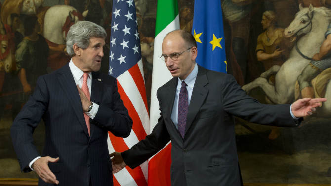 U.S. Secretary of State John Kerry, left, is greeted by Italian Premier Enrico Letta, upon his arrival at Rome's Chigi government palace, Thursday, May 9, 2013. Kerry is in Rome for a two-day visit. Kerry said Wednesday he would depart in two weeks on another trip to the Middle East to push peace between Israel and the Palestinians. (AP Photo/Andrew Medichini)