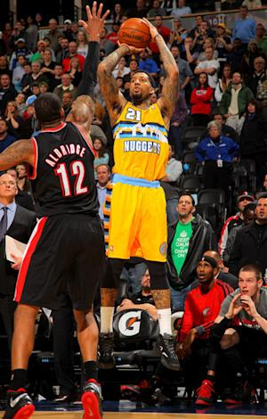 Chandler lifts Nuggets over Blazers 115-111 in OT