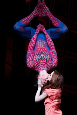 """In this theater publicity image released by The O&M Co., Reeve Carney and Jennifer Damiano are shown in a scene from """"Spider-Man: Turn Off The Dark."""" The reboot of the """"Spider-Man"""" musical on Broadway enjoyed a strong second straight week at the box office, leaving the two lead producers cautiously optimistic about the future of the show.""""Spider-Man: Turn Off the Dark"""" took in $1.7 million for the week ending Sunday, June 26. (AP Photo/The O&M Co., Jacob Cohl)"""