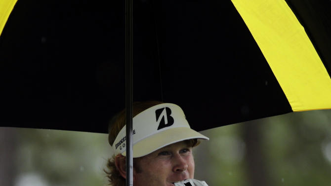 Brandt Snedeker removes his glove after teeing off on the fourth hole during the fourth round of the Masters golf tournament Sunday, April 14, 2013, in Augusta, Ga. (AP Photo/Matt Slocum)