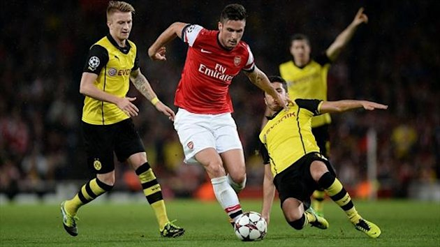Olivier Giroud, centre, scored in Arsenal's 2-1 home defeat to Borussia Dortmund