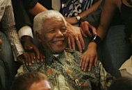 Former President Nelson Mandela greets recipients of the 2008 Mandela Rhodes scholarship at his offices in Johannesburg March 4, 2008. Mandela celebrates his 90th birthday on July 18. REUTERS/Antony Kaminju