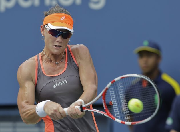 Samantha Stosur, of Australia, returns a shot to Victoria Azarenka, of Belarus, in the quarterfinals of the 2012 US Open tennis tournament,  Tuesday, Sept. 4, 2012, in New York. (AP Photo/Mike Groll)