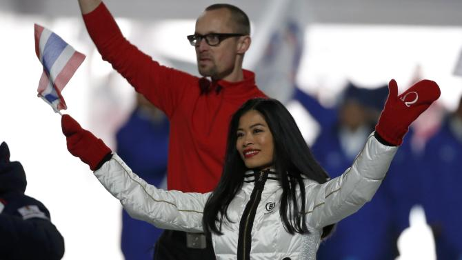 Violinist Vanessa-Mae Vanakorn, set to ski for Thailand, waves during the opening ceremony of the 2014 Sochi Winter Olympics