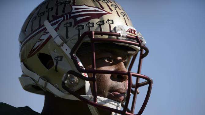 Florida State quarterback Jameis Winston warms up during NCAA college football practice in Carson, Calif., Sunday, Dec. 28, 2014. Florida State is scheduled to play Oregon in the Rose Bowl NCAA college football playoff semifinal on New Year's Day. (AP Photo/Kelvin Kuo)