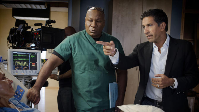 "This undated image released by TNT shows Ving Rhames portraying Dr. Jorge Villanueva, left, and Executive Producer Dr. Sanjay Gupta on the set of ""Monday Mornings,"" a medical drama premiering Monday, Feb. 4, 2013 at 10 p.m. EST on TNT. (AP Photo/TNT, Doug Hyun)"