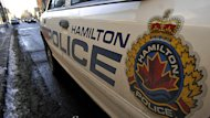 British authorities alerted Hamilton police that a woman from Hamilton had sent pornographic images of her children to a man in London.