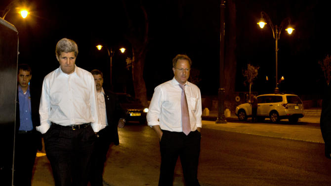 Escorted by security, U.S. Secretary of State John Kerry, left, walks with Frank Lowenstein, senior advisor to the secretary on Middle East issues, through the streets of Jerusalem just after 4 a.m. on Sunday, June 30, 2013 after finishing a meeting with Israeli Prime Minister Netanyahu that took over six hours. After the marathon meeting, Kerry decided to get some air by walking to a park near the hotel where he is staying and the meeting was held. Kerry is shuttling between Palestinian and Israeli leaders in hopes of restarting peace talks. (AP Photo/Jacquelyn Martin, Pool)