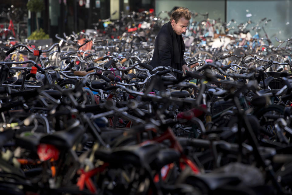 A man parks his bicycle near Central Station in Amsterdam, Netherlands, Wednesday Oct. 31, 2012. (AP Photo/Peter Dejong)