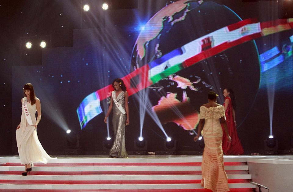 Miss Austria Ena Kadic, Miss Bahamas De'Andra Bannister and Miss Barbados Regina Ramjit walk on stage during opening of the 63rd Miss World Pageant ceremony in Nusa Dua, Bali, Indonesia on Sunday, Sept. 8, 2013. (AP Photo/Firdia Lisnawati)