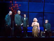In this April 20, 2012, photo provided by the Metropolitan Opera, Karita Mattila plays the 337-year-old Emilia Marty in Janacek&#39;s &quot;The Makropulos Case&quot; during a rehearsal at the Metropolitan Opera in New York. With Mattila are, from left, Alan Oke as Vitek, Tom Fox as Dr. Kolenaty, Johan Reuter as Jaroslav Prus. &quot;The Makropulos Case&quot; during a rehearsal at the Metropolitan Opera in New York. &quot;The Makropulos Case&quot; returned to the Met on Friday night, April 27, after an 11-year absence. (AP Photo/ Metropolitan Opera, Ken Howard)
