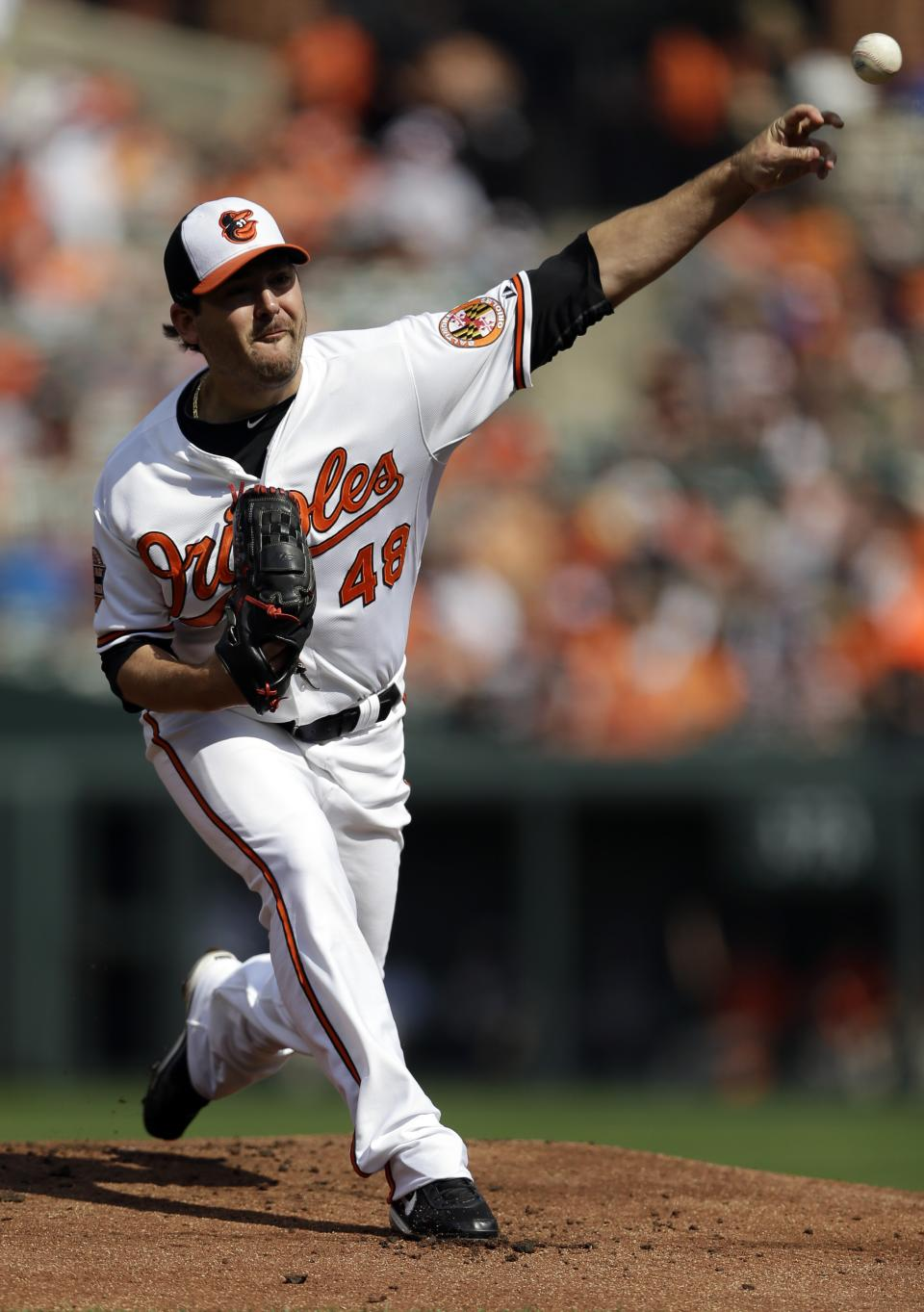 Baltimore Orioles starting pitcher Joe Saunders throws to the Boston Red Sox in the first inning of a baseball game in Baltimore, Sunday, Sept. 30, 2012. (AP Photo/Patrick Semansky)