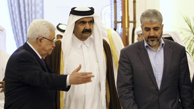 FILE - In this Feb. 6, 2012 file photo, the Emir of Qatar Sheikh Hamad Bin Khalifa Al-Thani, center, Palestinian President Mahmoud Abbas, left, and Hamas leader Khaled Mashaal, right, arrive to sign an agreement in Doha, Qatar. A rare public rift broke open Sunday, Feb. 12, 2012 in the usually tightly disciplined Islamic movement Hamas over a reconciliation deal that would require it to relinquish key areas of control in the Gaza Strip. (AP Photo/Osama Faisal, File)