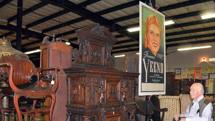 International pianist and vocal coach James Benner looks at a 16th century Burgundian French Dressoir, Thursday Aug. 28, 2014, at the Sagebrush Roundup, in Fairmont, West Virginia. The piece crafted in 1560 is one of the many items that he and his late wife, international opera star Frances Yeend, owned. Yeend sang with the New York City Metropolitan Opera for 12 years. She also performed with the Pittsburgh Opera, the New York Philharmonic, the Boston Symphony and the Philadelphia Orchestra. After retiring, she led the West Virginian University voice faculty from 1966-78. Yeend died April 27, 2008. Benner was a freelance coach and accompanist in New York City. For 15 years he was pianist for all major tours of the Obernkirchen Children's Choir from Germany, playing more than 1,000 concerts on five continents. Yeend and Benner toured internationally from the 1940s to the 1960s. Their lifetime collection will be sold at auction beginning Friday at the Sagebrush Round-Up. Collectors from every continent except Antarctica have signed up to bid on the vast collection of artworks, rugs, furniture and decorative arts. (AP Photo/Times West Virginian, Tammy Shriver)