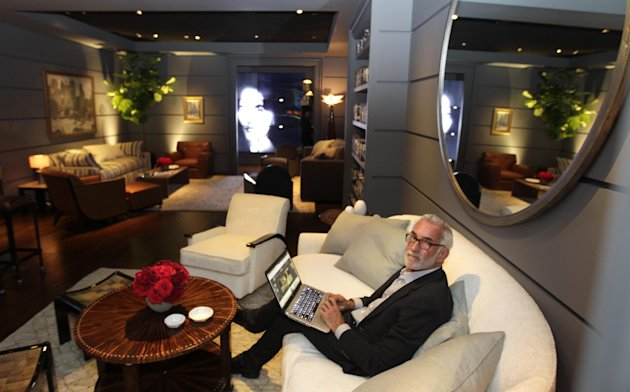 Interior designer Waldo Fernandez poses for a picture in the greenroom for the 84th Annual Academy Awards at the Kodak Theatre in Los Angeles, Thursday, Feb. 23, 2012. The Academy Awards will be held on Sunday.(AP Photo/Chris Carlson)