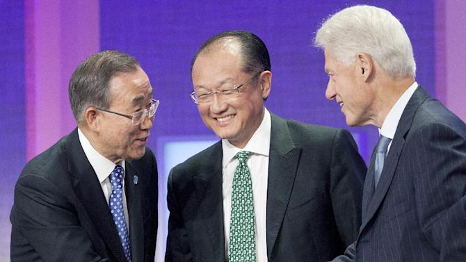United Nations Secretary-General Ban Ki-Moon, left, shakes hands with former U.S. President Bill Clinton after they participated in a panel discussion with World Bank President Jim Yong Kim, center, at the Clinton Global Initiative in New York on Sunday, Sept. 23, 2012. (AP Photo/Mark Lennihan)