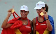 Romania's Georgeta Andrunache and Viorica Susanu celebrate after winning gold at the 2008 Beijing Olympics. The Romanian pair are seeking their fourth successive Olympic gold in the coxless pairs