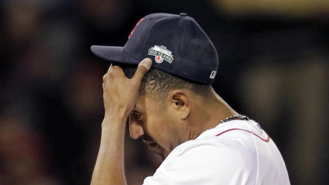 Boston Red Sox relief pitcher Franklin Morales reacts on the mound after giving up three runs to the Texas Rangers in the eighth inning of a baseball game at Fenway Park in Boston, Wednesday, April 18, 2012. (AP Photo/Elise Amendola)
