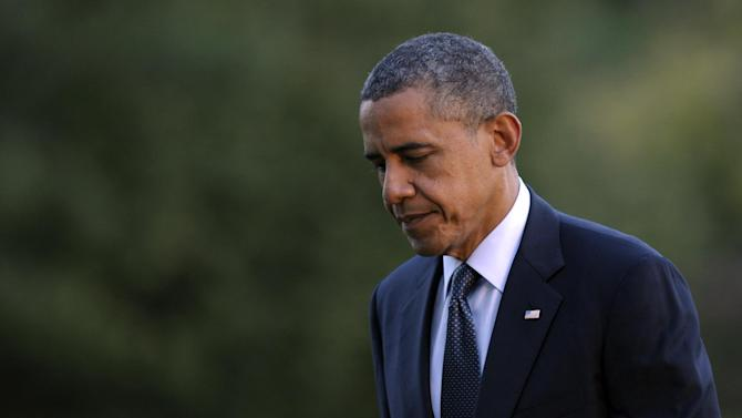 President Barack Obama walks from Marine One on the South Lawn of the White House in Washington, Thursday, Sept. 13, 2012. (AP Photo/Susan Walsh)