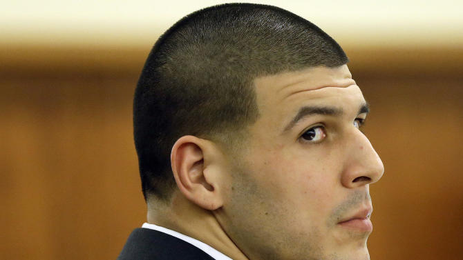 Former New England Patriots football player Aaron Hernandez listens during his murder trial, Thursday, Jan. 29, 2015, in Fall River, Mass. Hernandez is charged with killing semiprofessional football player Odin Lloyd, 27, in June 2013