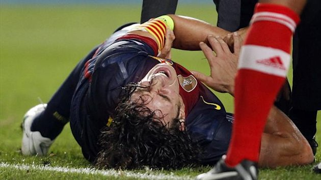 Barcelona defender Carles Puyol lies injured (Reuters)