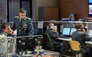 Davide Cardia (top) of the Guardia di Finanzia at work in the command centre. Tax officers in an anonymous office on the outskirts of Rome are on the frontlines of what Italian Prime Minister Mario Monti calls a war on endemic tax evasion as he struggles to fill public coffers