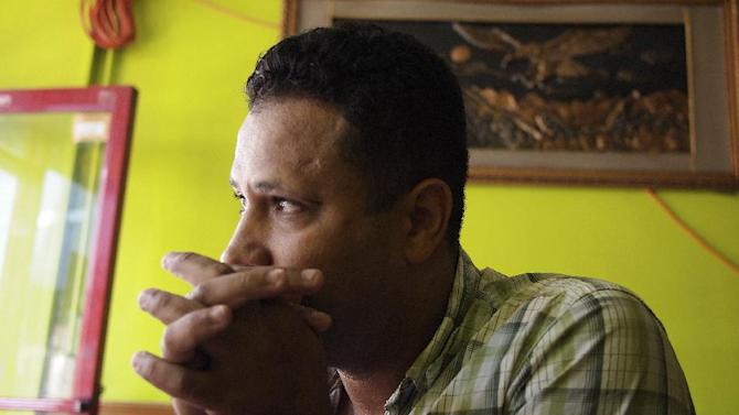 In this photo taken Friday, Sept. 2, 2011, Leo Santini, whose Egyptian name was originally Mohamed Hussein before he legally changed it, is interviewed in his Steinway Street coffee shop, which has in the past been under scrutiny by the New York Police Department, in the Astoria neighborhood of the Queens borough of New York. The New York Police Department subjected American citizens to surveillance and scrutiny, not because of any wrongdoing but because of their ethnicity. Documents obtained by The Associated Press describe a secret program known as the Moroccan Initiative, which catalogued where people of Moroccan ancestry shopped, ate and prayed. (AP Photo/Charles Dharapak)