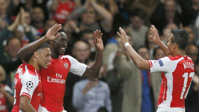 Arsenal's Danny Welbeck celebrates with team mate Alex Oxlade-Chamberlain and Alexis Sanchez after scoring a goal against Galatasaray during their Champions League soccer match in London