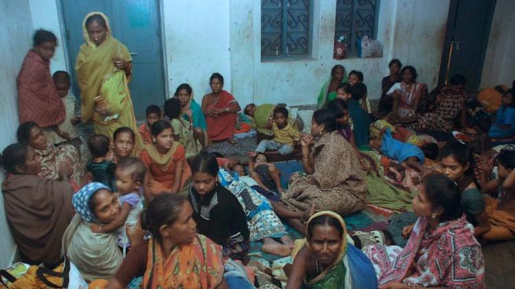 Indian residents rest in a cyclone shelter near Gopalpur, on October 11, 2013