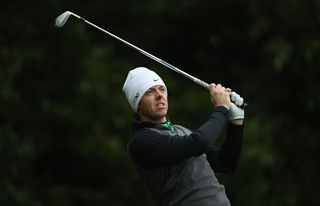 VIRGINIA WATER, ENGLAND - MAY 24:  Rory McIlroy of Northern Ireland plays his tee shot on the second hole during the second round of the BMW PGA Championship on the West Course at Wentworth on May 24, 2013 in Virginia Water, England.  (Photo by Andrew Redington/Getty Images)