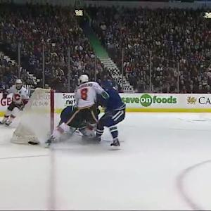 Eddie Lack stretches across to rob Colborne