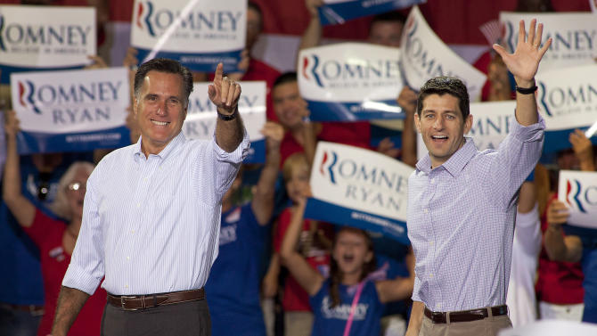 Republican presidential candidate Mitt Romney, left, and his vice presidential running mate Rep. Paul Ryan, R-Wis., arrive at a campaign rally Sunday, August 12, 2012 in Mooresville, N.C. at the NASCAR Technical Institute. (AP Photo/Jason E. Miczek)